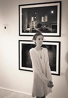 """Lene Marie Fossen foran to av sine bilder i serien """"Melancholia"""" hun stilte ut på Nordic Light 2017 i Kristiansund."""