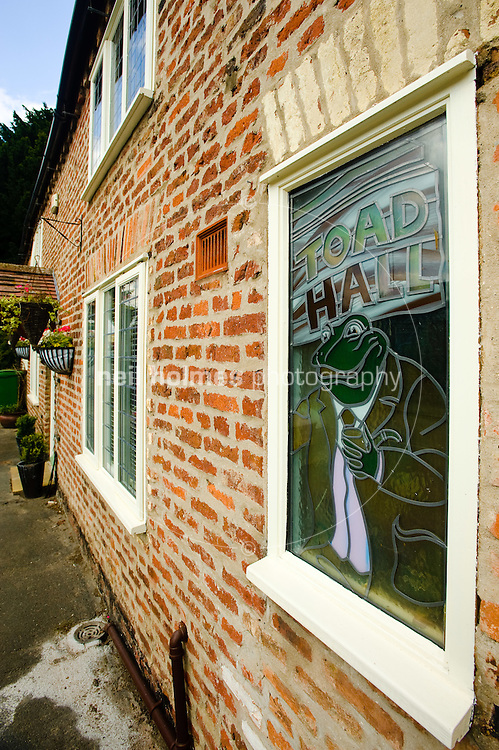 Stained Glass window of Toad of Toad Hall in a house on Middle Street, Kilham village East Yorkshire