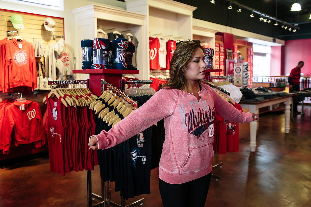 Elizabeth Navas searches for warmer Nationals clothing at the Washington Nationals Clubhouse Team Store as she expects the Nats to go deep into the playoffs this year. The Nationals and Baltimore Orioles clinched the first two post season spots within hours of one another.