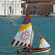 "VENICE, ITALY - JUNE 12:  A ""vela al terzo"" boat sails in St Mark's basing ahead of the Regatta of the Ancient Maritime Republics on June 12, 2011 in Venice, Italy. The idea of the Regatta of the Ancient Maritime Republics was realized in 1955 and the first edition took place in Genova."