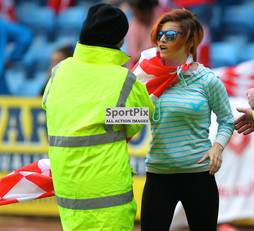 A Glenafton fan invades the pitch at the full time whistle during the Hurlford United FC V Glenafton Athletic FC Junior Scottish Cup Final 1st June 2014  ©Edward Linton | SportPix.org.uk