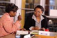 Rosalyn Smith of Soul Purpose (left) and Joan Johnson-Walker of JJW Consultants, LLC during the Women in Business Networking 'Hot Topics' Koffee Talk at the Dorothy Lane Market in Springboro, Friday, March 4, 2011.