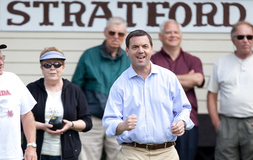 Ontario PC leader Tim Hudak celebrates making a shot during a campaign stop at the Stratford Lawn Bowling club in Stratford, Ontario, Wednesday, September 14, 2011.<br /> THE CANADIAN PRESS/ Geoff Robins