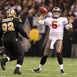 Dec 27, 2009; New Orleans, LA, USA; Tampa Bay Buccaneers quarterback Josh Freeman (5) throws past New Orleans Saints defensive tackle Remi Ayodele (92) during the third quarter at the Louisiana Superdome. Mandatory Credit: Derick E. Hingle-US PRESSWIRE..