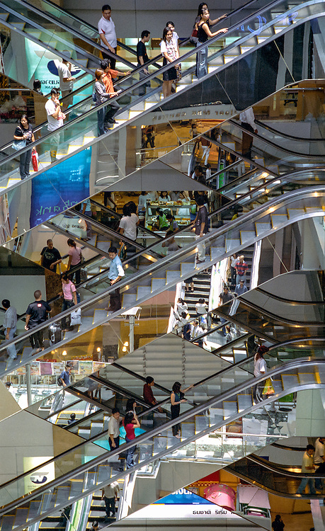 Confusion of escalators and reflections at the MBK shopping center in Bangkok, Thailand, 2003.