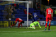AFC Wimbledon attacker Michael Folivi (17) scoring goal to make it 2-0 during the Leasing.com EFL Trophy match between AFC Wimbledon and Leyton Orient at the Cherry Red Records Stadium, Kingston, England on 8 October 2019.