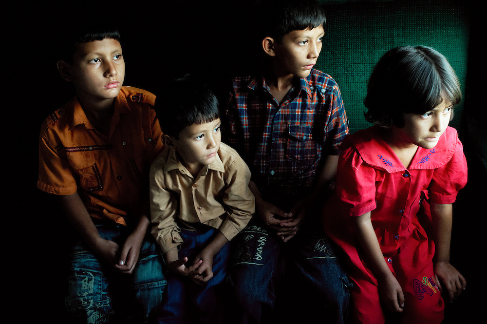 Mairaj Hassam, 7 years old, 4th class, SirajHassam, 3 years old, Kindergarten.Murraza Hassam, 18 months old, ShabbirHassam, 10 years old, 6th class and .Tatheer Fatima, 4 years old, 1st class sit on the Khyber Mail traveling from Rawalpindi to Karachi on August 13, 2011. They are from Skardu, Baltistan Chunda region of Pakistan and traveling with their father.