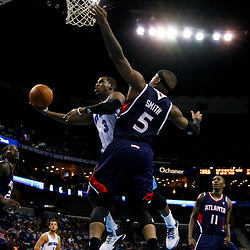 December 26, 2010; New Orleans, LA, USA; New Orleans Hornets point guard Chris Paul (3) shoots over Atlanta Hawks power forward Josh Smith (5) during the first half at the New Orleans Arena.  Mandatory Credit: Derick E. Hingle