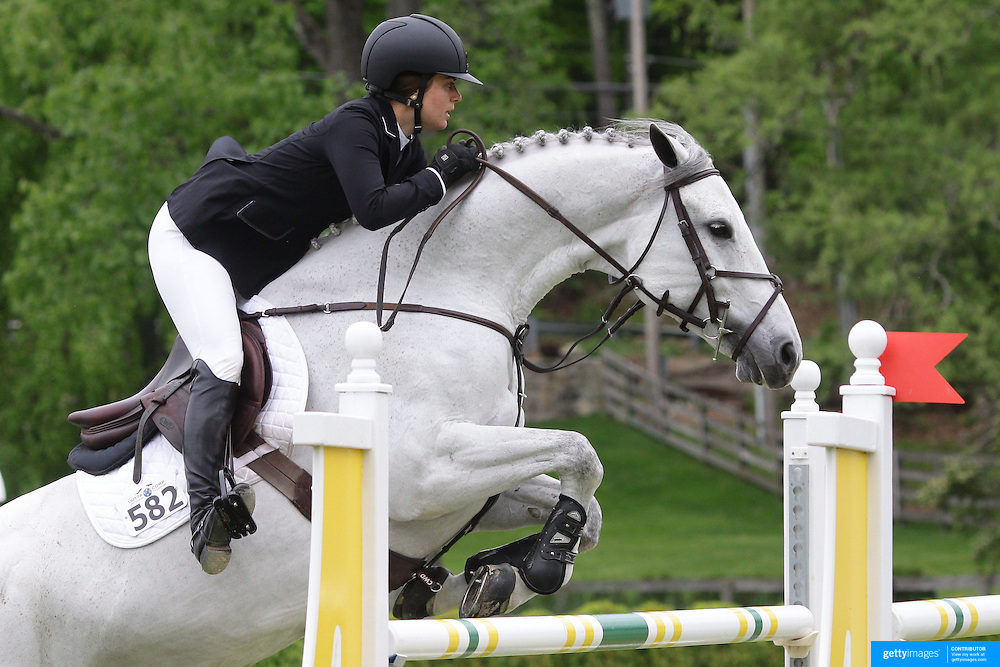 NORTH SALEM, NEW YORK - May 21: Kelly Tropin riding Don't Stop O in action during The $15,000 Under 25 T & R Development Grand Prix at the Old Salem Farm Spring Horse Show on May 21, 2016 in North Salem, New York. (Photo by Tim Clayton/Corbis via Getty Images)