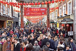 © Licensed to London News Pictures. 18/02/2018. LONDON, UK.  Gerrard Street in Chinatown is packed full of people during the Chinese New Year celebrations for the Year of the Dog.  Hundreds of thousands of Londoners and tourists have descended on the capital to enjoy the festivities which is the biggest such celebration outside Asia.  Photo credit: Stephen Chung/LNP