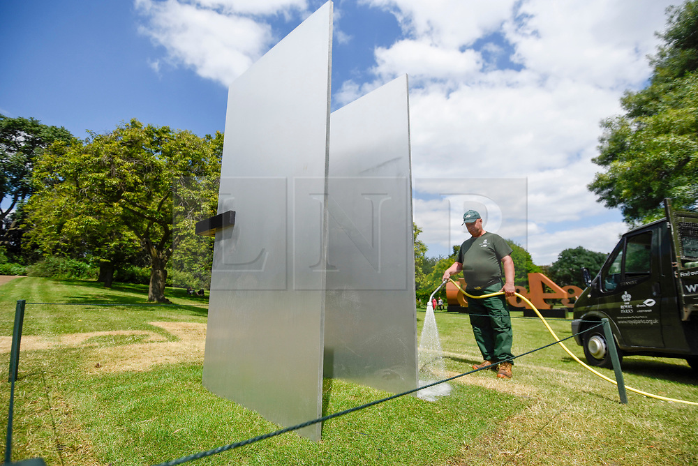 "© Licensed to London News Pictures. 03/07/2019. LONDON, UK. ""A Stranger Holding Two Wings"", 2018, by Tai-Jung-Um. Frieze Sculpture opens in Regent's Park, London's largest free display of outdoor art.  Works from 23 international artists are on display 3 July to 6 October 2019.  Photo credit: Stephen Chung/LNP"
