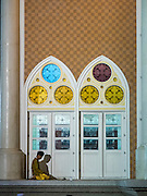 18 JUNE 2015 - PATTANI, PATTANI, THAILAND: A man prays near the side door of Pattani Central Mosque on the first day of Ramadan. Thousands of people come to Pattani Central Mosque in Pattani, Thailand, to mark the first night of Ramadan. Ramadan is the ninth month of the Islamic calendar, and is observed by Muslims worldwide as a month of fasting to commemorate the first revelation of the Quran to Muhammad according to Islamic belief. This annual observance is regarded as one of the Five Pillars of Islam. Islam is the second largest religion in Thailand. Pattani, along with Narathiwat and Yala provinces, all on the Malaysian border, have a Muslim majority.     PHOTO BY JACK KURTZ