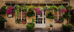 Hanging baskets of flowers outside a restaurant in Duras, Lot et Garonne, Aquitaine, France<br /> <br /> (c) Andrew Wilson | Edinburgh Elite media