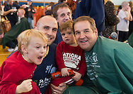 At right, PETE MAGNUSON, Calhoun High School teacher and coordinator of its St. Baldrick's head shaving event, is with other participants at the charity event.  Calhoun exceeded its goal of raising $50,000 for childhood cancer research. Plus, many ponytails cut off will be donated to Locks of Love foundation, which collects hair donations to make wigs for children who lost their hair due to medical reasons.