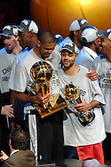 The San Antonio Spurs' Tim Duncan, left, and MVP Tony Parker hold up trophies after sweeping the Cleveland Cavaliers in four games in the 2007 NBA Finals.