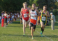 City High's Brook Price (425), Prairie's Mitch Pritts (545), and West's Daniel Gardarsson (840) battle it out up a hill during the Cedar Rapids Invitational at Noelridge Park in Cedar Rapids on Thursday, September 6, 2012. Price placed third with a time of 16:07.13, Pritts placed fifth with a time of 16:09.06, and Gardarsson placed seventh with a time of 16:11.45.