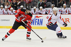 Jan 25, 2013; Newark, NJ, USA; New Jersey Devils center Jacob Josefson (16) skates with the puck past Washington Capitals defenseman Tomas Kundratek (36) during the first period at the Prudential Center.