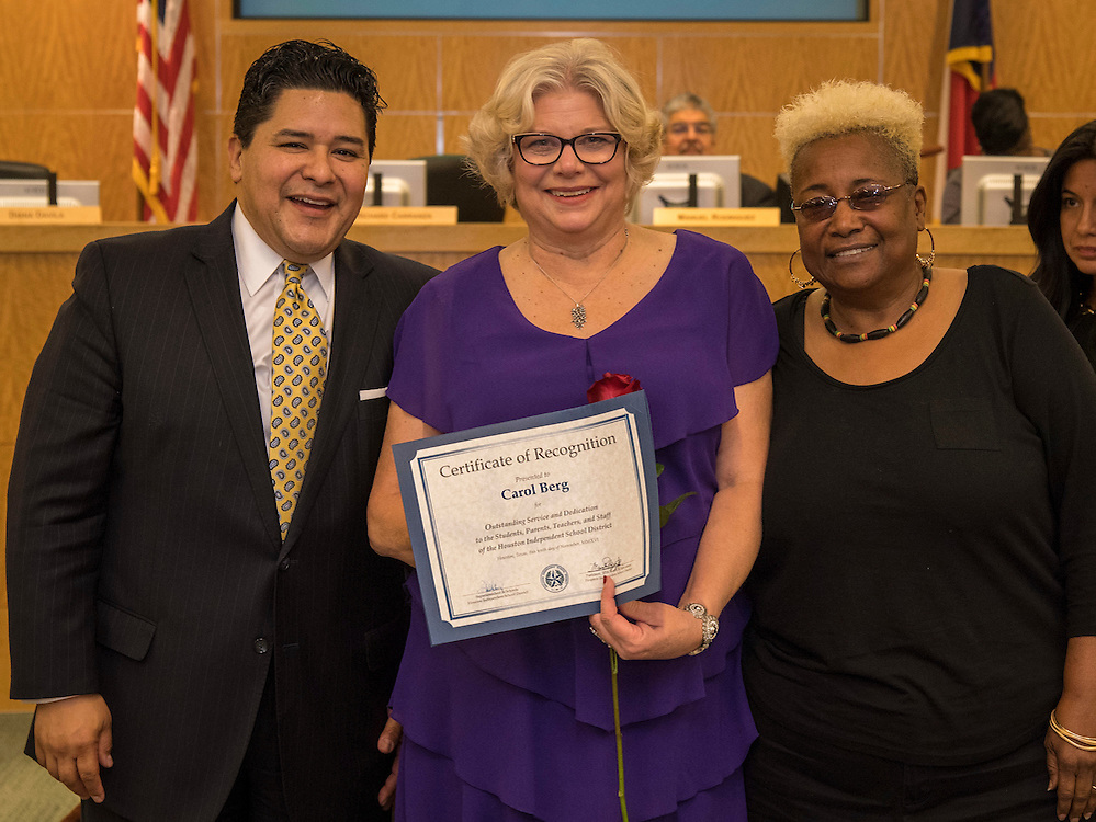 Superintendent Richard Carranza, left, and Wretha Thomas, right, recognize Carol Berg, center, during the Houston ISD Board of Trustee meeting, November 10, 2016.