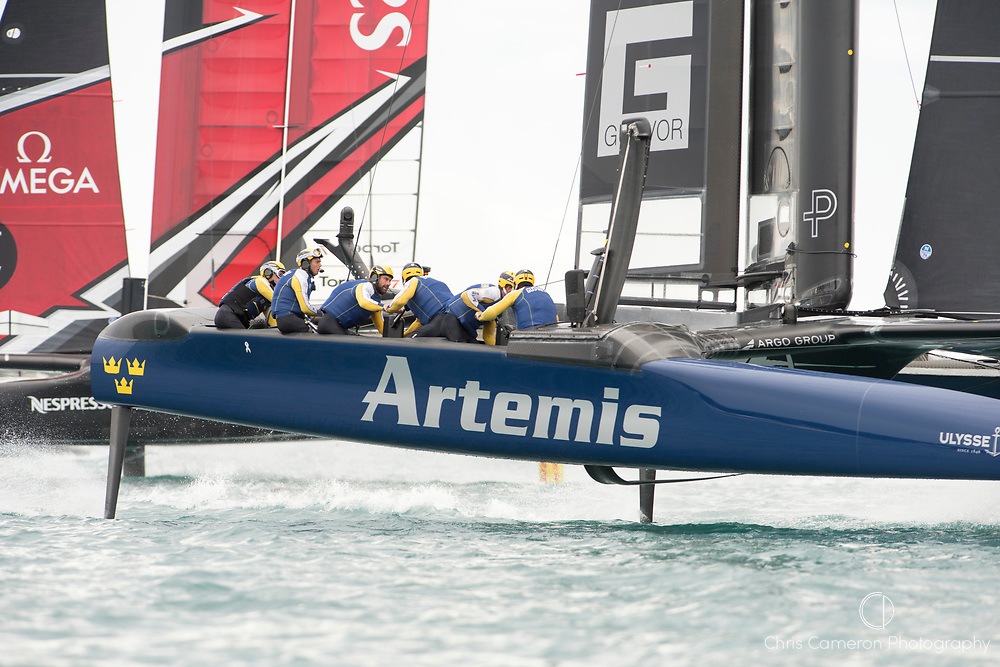 The Great Sound, Bermuda. 11th June 2017. Emirates Team New Zealand and Artemis Racing (SWE) cross in race four of the Louis Vuitton America's Cup Challenger playoff finals. Artemis won the race to level the standings at 2 - 2.