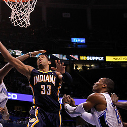 March 11, 2012; Orlando, FL, USA; Indiana Pacers small forward Danny Granger (33) shoots over Orlando Magic forward Earl Clark (3) and center Dwight Howard (12) during the third quarter of a game at  Amway Center. The Magic defeated the Pacers 107-94.  Mandatory Credit: Derick E. Hingle-US PRESSWIRE