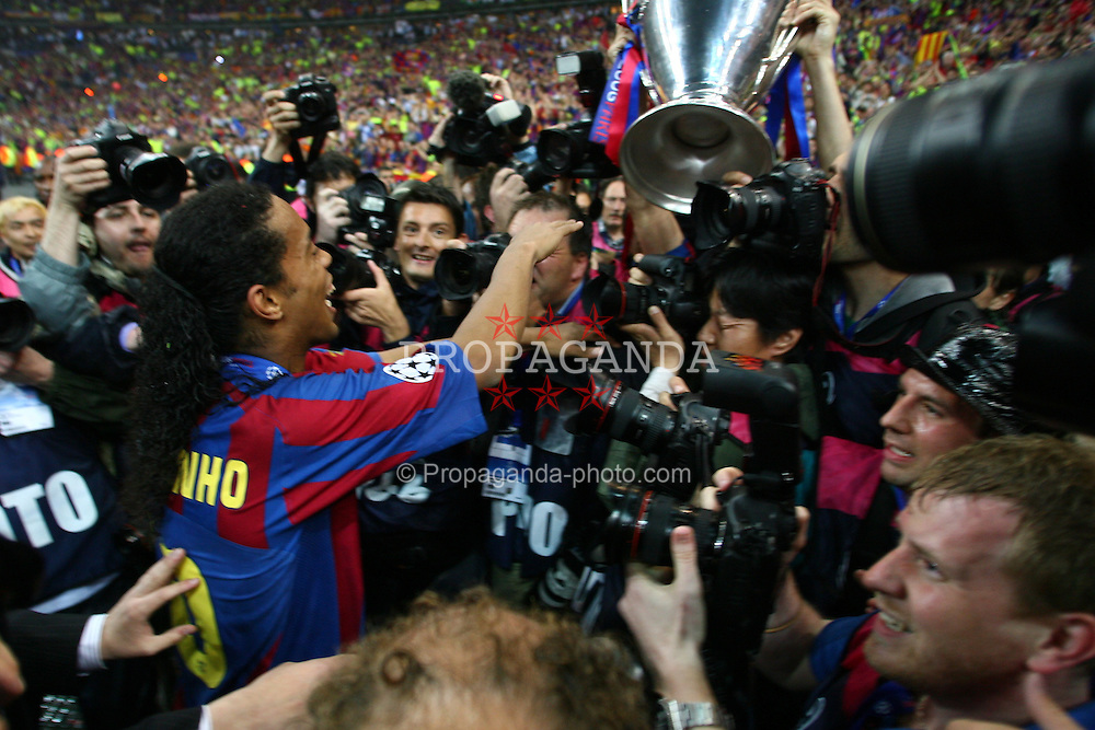 PARIS, FRANCE - WEDNESDAY, MAY 17th, 2006: FC Barcelona's Ronaldinho celebrates winning the European Cup as he disappears into a pack of photographers during the UEFA Champions League Final at the Stade de France. (Pic by David Rawcliffe/Propaganda)