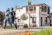 Couple Crossing the Street at El Camino Real and Avenida Del Mar in San Clemente