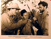 "Alexander ""Sasha"" Siemel (right) holding his zagaya (spear) with Frank Buck (left) in promotional still for the movie ""Jungle Menace"""