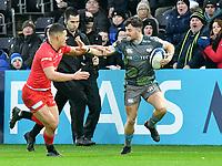 Rugby Union - 2019 / 2020 European Rugby Heineken Champions Cup - Pool Four: Ospreys vs. Saracens<br /> <br />  Luke Morgan of Ospreys hands off  Manu Vunipola of Saracens, at the Liberty Stadium.<br /> <br /> COLORSPORT/WINSTON BYNORTH