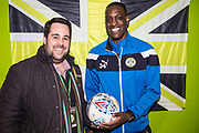 Match sponsor Grundon with Forest Green Rovers Isaiah Osbourne(34) during the EFL Sky Bet League 2 match between Forest Green Rovers and Crawley Town at the New Lawn, Forest Green, United Kingdom on 24 February 2018. Picture by Shane Healey.
