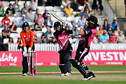 Maddy Green of New Zealand hits the ball past Katey Martin of New Zealand for 4 runs during the International T20 match between England Women Cricket and New Zealand at the Cooper Associates County Ground, Taunton, United Kingdom on 23 June 2018. Picture by Graham Hunt.