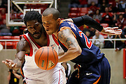 Utah forward Jay Watkins, left, and Pepperdine guard Lorne Jackson, right, go after a loose ball during the second half of an NCAA basketball game, Dec. 7, 2010 in Salt Lake City. Utah defeated Pepperdine 67-60. (AP Photo/Colin E Braley)