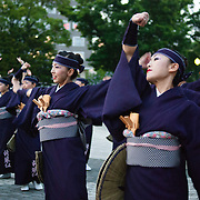 A group of japanese female performers practice in Odori park before the big premiere, Sapporo.