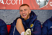 Oliver McBurnie (#20) of Scotland is all smiles on the bench before the UEFA European 2020 Group I qualifier match between Scotland and Kazakhstan at Hampden Park, Glasgow, United Kingdom on 19 November 2019.