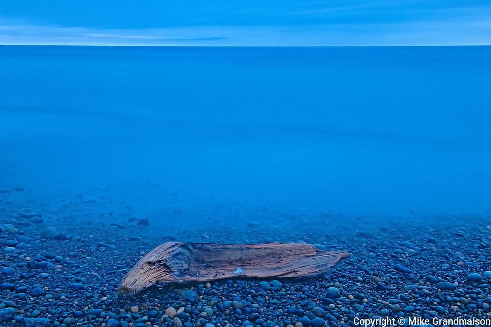 Driftwood on Agate Beach at dusk. Pacific Ocean. Naikoon Provincial Park. Graham Island. , Haida Gwaii (formerly the Queen Charlotte Islands), British Columbia, Canada