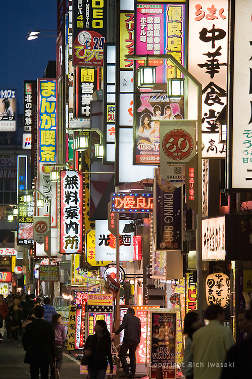 Neon signs at dusk in the Kabukicho area, Shinjuku district, Tokyo, Japan
