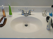 faucet and sink with various toiletry