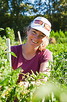 Portrait of a woman working in her garden plot in a community garden in Seattle, WA USA