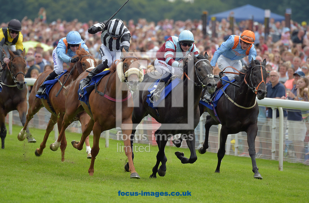 Get Knotted ridden by Paul Mulrennan (black with white stripes and striped cap) wins Read Richard Fahey's Column at sportinglife.com stakes  during the Sky Bet York Stakes meeting at York Racecourse, Yorkshire, UK.<br /> Picture by Martin Lynch/Focus Images Ltd 07501333150<br /> 23/07/2016