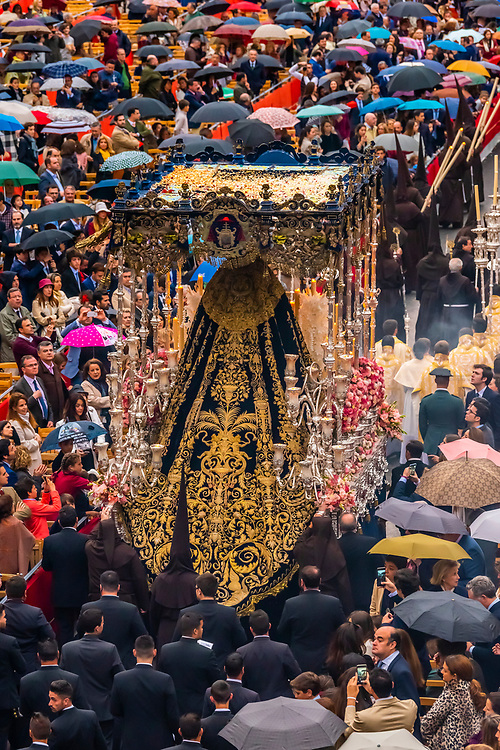 A paso (float) of the Virgin Mary in the procession of the Brotherhood (Hermandad) El Buen Fin, Holy Week (Semana Santa), Seville, Andalusia, Spain.