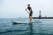 Jack Haworth paddling on Lake Michigan with the Chicago skyline in the background.
