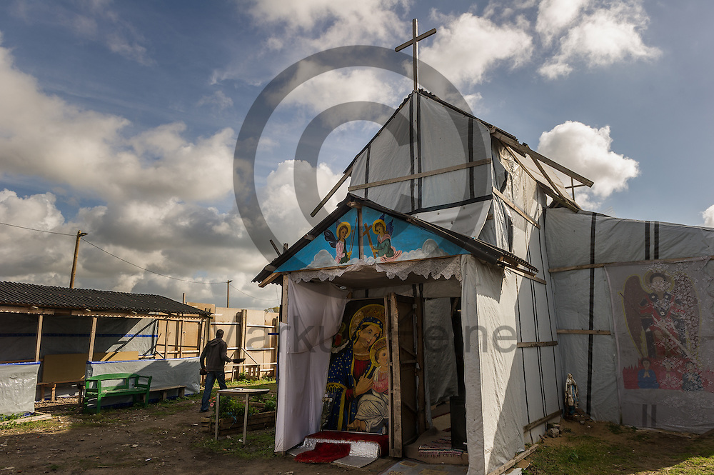 Calais, Frankreich - 17.10.2016<br /> Eine Kirche f&uuml;r &auml;thiopische und eritreische Christen   steht im Dschungel von Calais. Das Fluechtlingscamp an der Kueste zum Aermelkanal soll laut franz&ouml;sischer Regierung in den n&auml;chsten Tagen geraeumt werden. In dem Camp leben um die 1000 Fluechtlinge und warten auf die Moeglichkeit zur Weiterreise durch den Eurotunnel nach Gro&szlig;britannien. Photo: Foto: Markus Heine / heineimaging<br /> <br /> Calais, France - 2016/10/17<br /> A Church for Ethiopian and Eritrean Christians stand in the Calais Jungle. The refugee camp on the coast to the English Channel is to be cleared in the next few days, according to the French government. In the camp live around the 1000 refugees and wait for the possibility to travel further through the Eurotunnel to the UK. Photo: Foto: Markus Heine / heineimaging<br /> <br /> ------------------------------<br /> <br /> Ver&ouml;ffentlichung nur mit Fotografennennung, sowie gegen Honorar und Belegexemplar.<br /> <br /> Bankverbindung:<br /> IBAN: DE65660908000004437497<br /> BIC CODE: GENODE61BBB<br /> Badische Beamten Bank Karlsruhe<br /> <br /> USt-IdNr: DE291853306<br /> <br /> Please note:<br /> All rights reserved! Don't publish without copyright!<br /> <br /> Stand: 10.2016<br /> <br /> ------------------------------