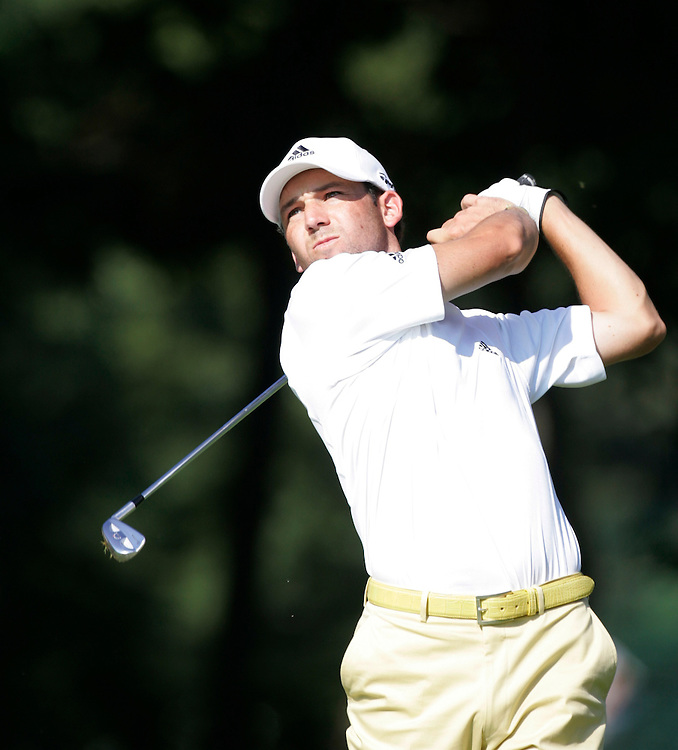 Sergio Garcia hits his tee shot on the 18th hole during a practice round at Baltusrol Golf Club Springfield, NJ Wednesday 9 August 2005.