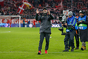 Liverpool manager Jurgen Klopp applauds the travelling Liverpool fans after the Champions League match between Bayern Munich and Liverpool at the Allianz Arena, Munich, Germany, on 13 March 2019.