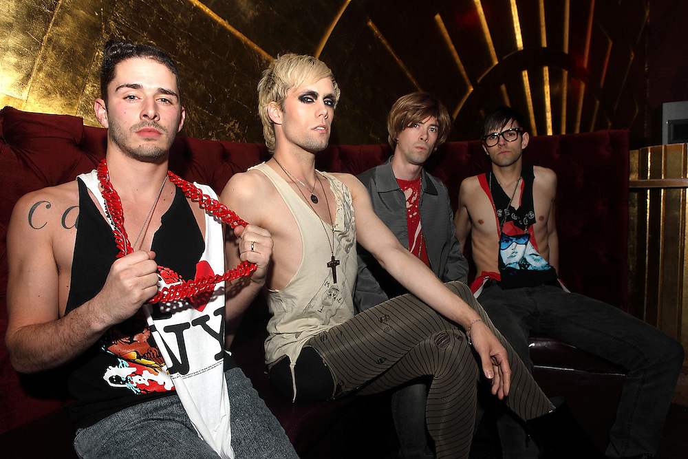 NEW YORK - APRIL 23:  Cole Whittle, Justin Tranter, Stevy Pyne and Dan Crean of Semi Precious Weapons backstage before their performance at Webster Hall on April 23, 2009 in New York City.  (Photo by Roger Kisby)