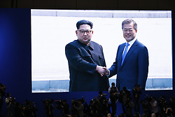 April 27, 2018 - Goyang, South Korea - A screen broadcasting South Korean President Moon Jae-in (R) shaking hands with top leader of the Democratic People's Republic of Korea (DPRK) Kim Jong Un in the border village of Panmunjom. Moon Jae-in arrived Friday morning in the border village of Panmunjom for his first summit with Kim Jong Un. (Credit Image: © Wang Jingqiang/Xinhua via ZUMA Wire)