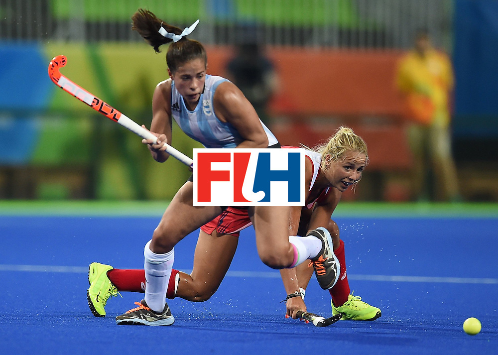 Argentina's Lucina von der Heyde (L) vies for the ball with the USA's Kelsey Kolojejchick  during the women's field hockey Argentina vs USA match of the Rio 2016 Olympics Games at the Olympic Hockey Centre in Rio de Janeiro on August, 6 2016. / AFP / MANAN VATSYAYANA        (Photo credit should read MANAN VATSYAYANA/AFP/Getty Images)