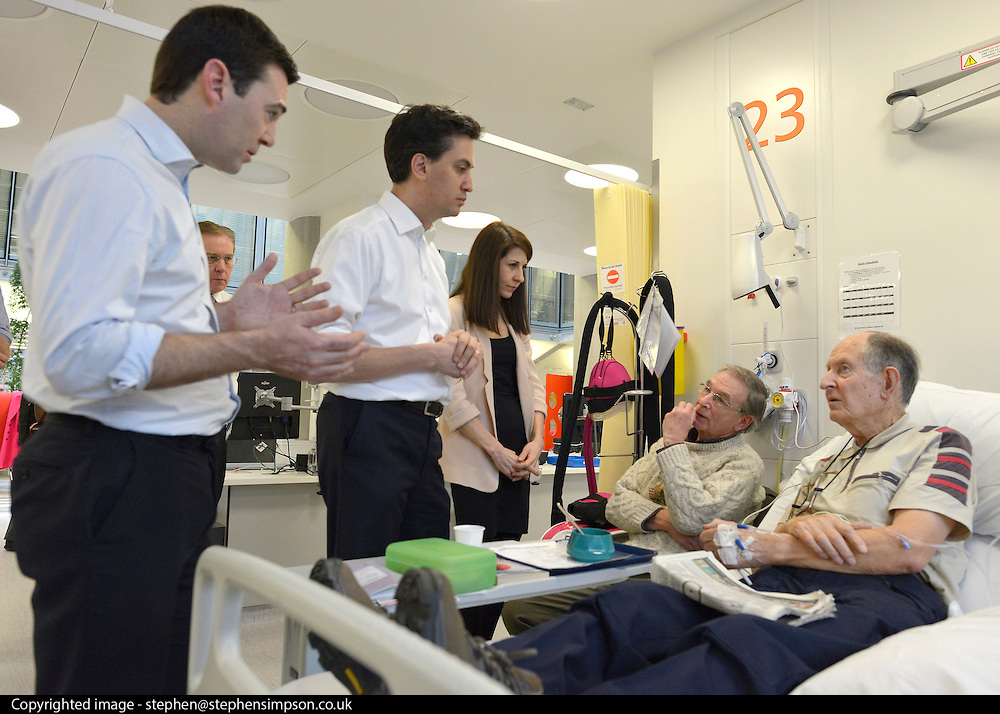 © Licensed to London News Pictures. 24/01/2013. London, UK L-R Andy Burnham, Ed Miliband, Liz Kendall, (sitting) Bob Harris (On Bed) Ray Barnes. Leader of the Labour Party, Ed Miliband, Shadow Health Secretary Andy Burnham and Shadow Health Minister Liz Kendall visit the Macmillan Cancer Centre at University College Hospital in Central London today, 24 January 2013. Today the Labour Party launched its Whole Person Care policy review. Photo credit : Stephen Simpson/LNP