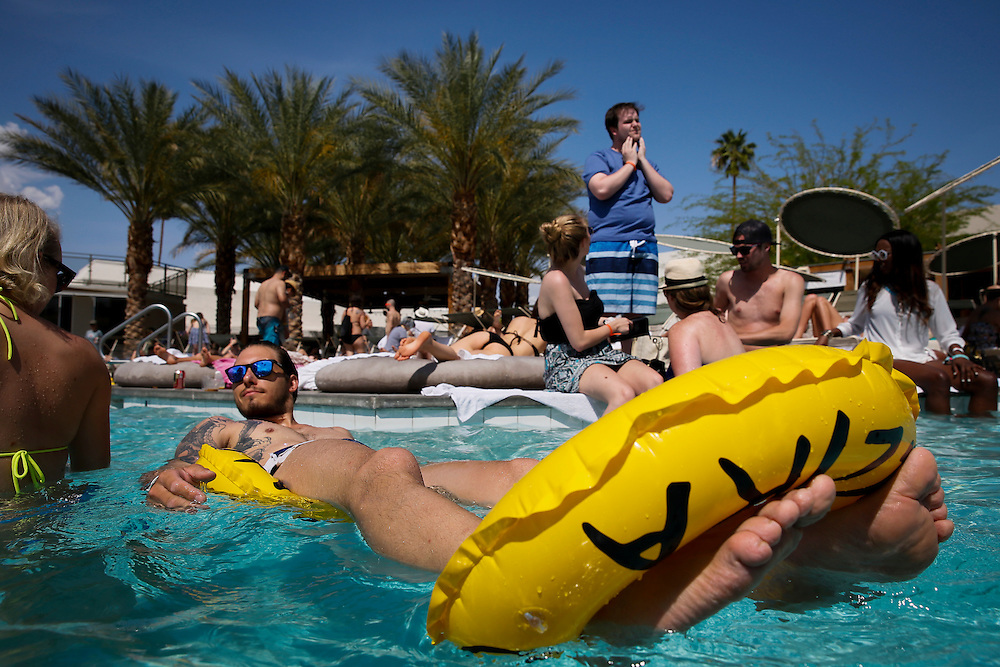 Loic Bonin, of Paris, France, lounges in the pool during the Desert Gold 2014 pool party at the ACE Hotel & Swim Club, Coachella weekend on Saturday, April 19, 2014 in Palm Springs, California.© 2014 Patrick T. Fallon, No Use Without Permission