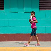 A girl walks down the sidewalks in San Juan del Sur, Nicaragua.  (Photo/William Byrne Drumm)