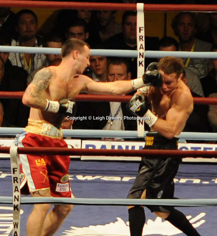 Michael Katsidis (black shorts) defeats Kevin Mitchell at Upton Park (West Ham Football Club) on the 15th May  2010. Frank Warren Promotions. Photo credit © Leigh Dawney